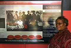 Roslyn Hunt stands next to a poster at Project 500 Gala