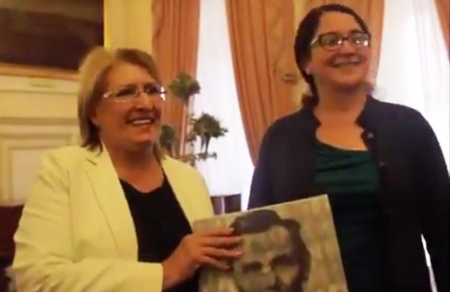 Malta President Marie Louise Coleiro Preca receives a gift from Professor Linda Herrera