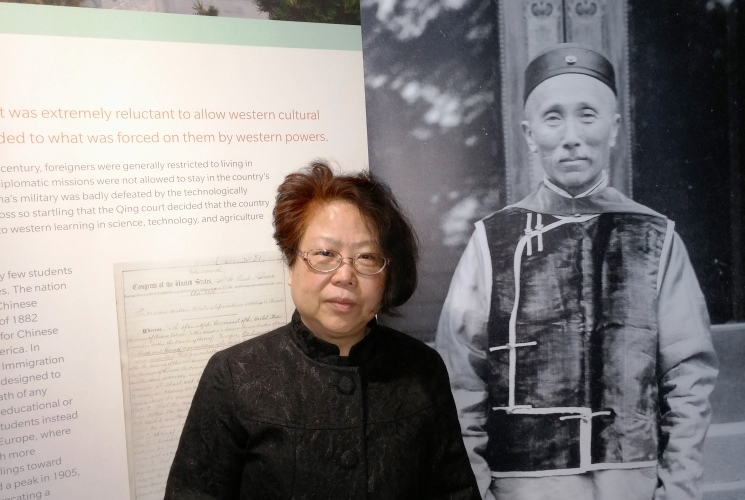 College of Education alumna Carol Huang at 'East Meets West' exhibit at Spurlock Museum in Urbana