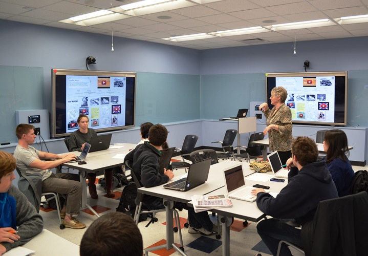 Instructor Lynn Burdick with class in Lab Room of Education Building